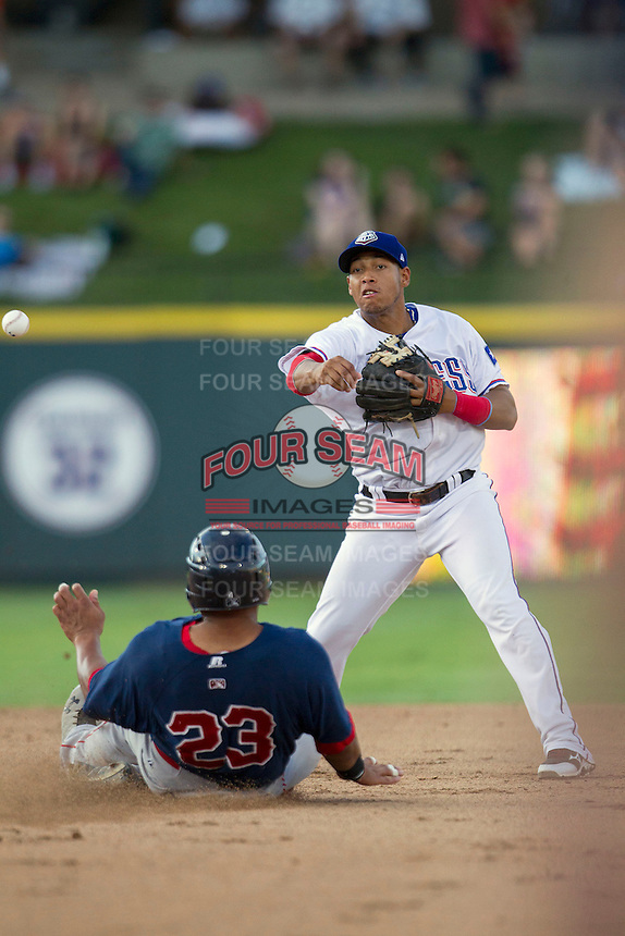 Round Rock Express second baseman Yangervis Solarte (26) turns a double play against the Oklahoma City RedHawks during the Pacific Coast League baseball game on August 25, 2013 at the Dell Diamond in Round Rock, Texas. Round Rock defeated Oklahoma City 9-2. (Andrew Woolley/Four Seam Images)
