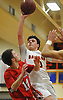 Joseph Rende #10 of Babylon puts up a shot during a Suffolk County League VII varsity boys basketball game against Center Moriches at Babylon High School on Friday, Jan. 26, 2018. Center Moriches won by a score of 84-80.