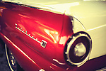 Red classic car highlighting the tailight