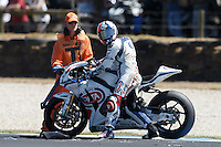 Leon Haslam (GBR) riding the Honda CBR1000RR (91) of the Pata Honda World Superbike Team crashes at turn 11 during a practise session on day two of round one of the 2013 FIM World Superbike Championship at Phillip Island, Australia.