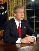 United States President George W. Bush speaks to the nation from the Oval Office of the White House in Washington, DC on March 19, 2003 announcing the start of the military action called Operation Iraqi Freedom against President Saddam Hussein of Iraq.<br /> Credit: Alex Wong - Pool via CNP