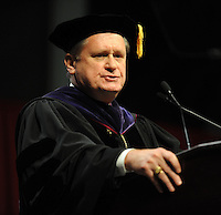 NWA Media/ANDY SHUPE - David Gearhart, chancellor of the University of Arkansas, speaks during fall commencement exercises Saturday, Dec. 20, 2014, at Barnhill Arena on the university campus in Fayetteville.