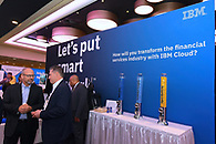 Conference attendees chatting at the IBM booth.