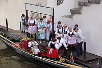 Pilgrims from around the world traditionally come to Prague to honour Saint John of Nepomuk.<br /> Venetian gondoliers come to Prague every year for this celebration. Saint John of Nepomuk is the patron of all gondoliers and one of the eight patrons of Venice. The statue of Saint John of Nepomuk is the only Baroque statue situated right on the bank of the Grand Canal in Venice, Italy.<br /> <br /> Twelve-year-old Frantisek Libosvar dressed as a girl and with a rose in his mouth leads the royal procession during Ride of the Kings as part of Navalis Celebrations on May 15, 2015 in Prague, Czech Republic. The Navalis Saint John's celebrations take place to commemorate Czech saint and Prague native, Saint John of Nepomuk, patron of all people of the water. <br /> <br /> <br /> The Ride of the Kings takes place during the spring, as a part of the Pentecost traditions . A group of young men ride through a Prague in a ceremonial procession. The ride is headed by chanters, followed by pageboys with unsheathed sabres who guard the King &ndash; a young boy with his face partially covered, holding a rose in his mouth &ndash; and the rest of the royal cavalcade. The King and pageboys are dressed in women&rsquo;s ceremonial costumes, while the other riders are dressed as men. The entourage rides on decorated horses, stopping to chant short rhymes that comment humorously on the character and conduct of spectators. The chanters receive donations for their performance, placed either in a money box or directly into the riders&rsquo; boots. The King&rsquo;s retinue returns home after a few hours of riding, and celebrates in the evening at the house of the King with a small feast, music and dancing. The practices and responsibilities of the Ride of the Kings are transmitted from generation to generation. The traditional paper decorations for the horses and the ceremonial costumes, in particular, are made by women and girls familiar with the processes, colour patterns and shapes specific to each village