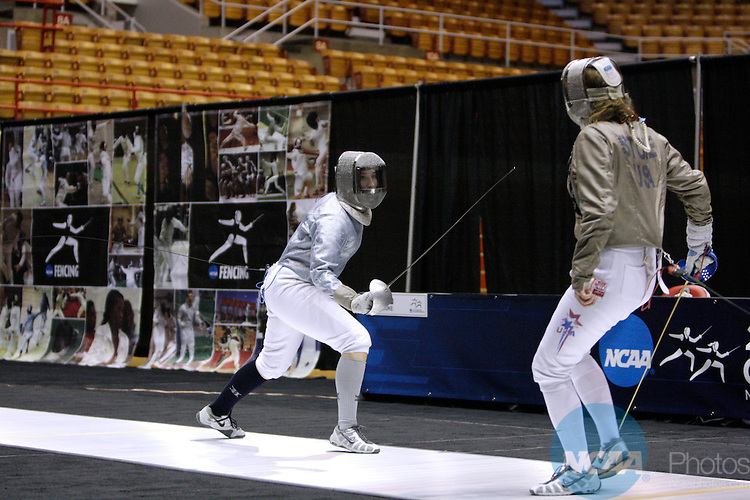 27 MAR 2011:  Rebecca Ward, left, of Duke fences against Eliza Stone of Princeton in the saber competition of the Division I Women's Fencing Championship held at St. John Arena on the Ohio State University campus in Columbus, OH. Ward defeated Stone 15-12  to claim the national title. Jay LaPrete/ NCAA Photos