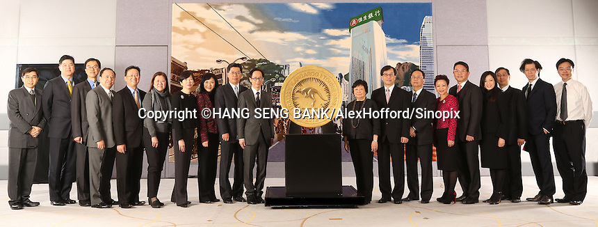 A Hang Seng Bank handout photo shows the enitre Hang Seng Bank senior management team flanking what the bank says is the world's largest gold coin, Hong Kong, China, 09 January 2014. Hang Seng Bank has been awarded the exclusive right to display the monster coin, the '2012 Australian Kangaroo One Tonne Gold Coin', in Hong Kong. Issued by The Perth Mint as legal tender with a monetary denomination of one million Australian dollars (Euro 655,704.00), the coin contains one tonne of 99.99% pure gold and is officially recognised by Guinness World Records as the largest and heaviest coin in the world. As at 8 January, the gold value of the coin is more than HKD305 million (Euro 28,911,715.00). It is the first time the coin has been available for public viewing outside Australia.