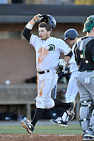 Center fielder Cody Brittain (18) of the University of South Carolina Upstate Spartans crosses the plate after hitting a two-run home run in the fifth inning of a game against the George Mason Patriots on Friday, February 19, 2016, at Cleveland S. Harley Park in Spartanburg, South Carolina. (Tom Priddy/Four Seam Images)