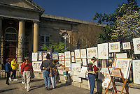 AJ3358, Charleston, South Carolina, street art, Tourists walk by displays of artwork for sale on fence in front of St. Philip's Episcopal Church in Charleston in the state of South Carolina.