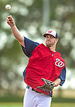 22 February 2013: Washington Nationals' outfielder Bryce Harper warms up during a full squad Spring Training workout at Space Coast Stadium in Viera, Florida. Mandatory Credit: Ed Wolfstein Photo *** RAW File Available ***