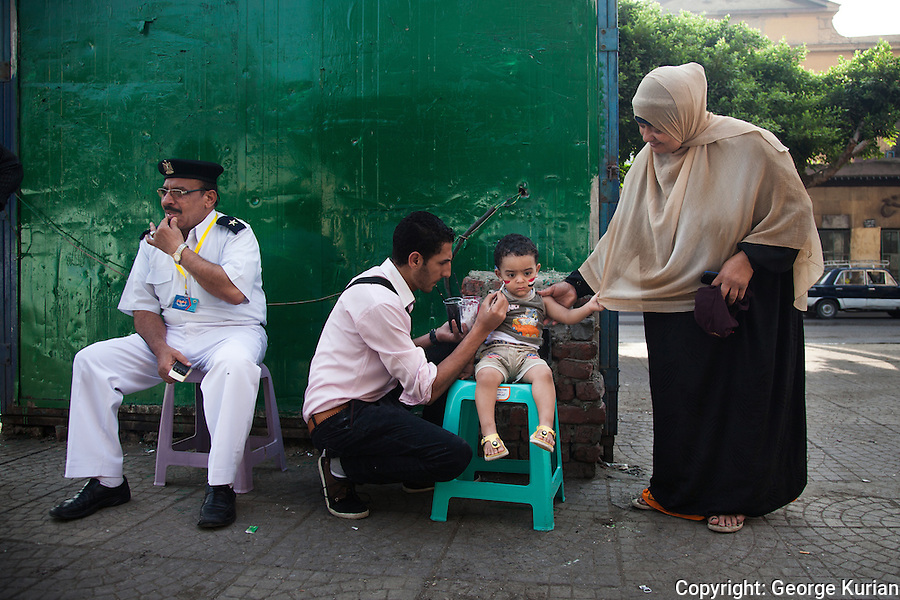 Scenes outside a polling station in Shubra, Cairo.<br />