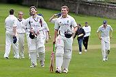 Cricket Scotland - Scottish Championship Grand Final - Watsonians CC V Dumfries CC- at Grange Loan (Edinburgh) - smiles of success for Watsonians as Ewan Chalmers (centre right - 70 not out) leads teammate Mark Yellowlees off the field after securing victory - 08.9.12 - 07702 319 738 - clanmacleod@btinternet.com - www.donald-macleod.com