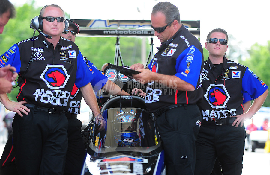 May 6, 2012; Commerce, GA, USA: NHRA crew members for top fuel dragster driver Antron Brown during the Southern Nationals at Atlanta Dragway. Mandatory Credit: Mark J. Rebilas-