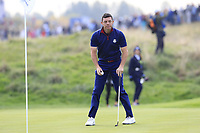 Rory McIlroy Team Europe on the 9th green during Friday's Fourball Matches at the 2018 Ryder Cup, Le Golf National, Iles-de-France, France. 28/09/2018.<br /> Picture Eoin Clarke / Golffile.ie<br /> <br /> All photo usage must carry mandatory copyright credit (© Golffile | Eoin Clarke)