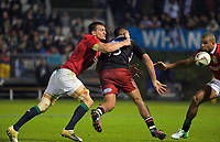 Luteru Laulala gets his pass away in the tackle of Sam Warburton (left) during the 2017 DHL Lions Series rugby union match between the NZ Provincial Barbarians and British & Irish Lions at Toll Stadium in Whangarei, New Zealand on Saturday, 3 June 2017. Photo: Dave Lintott / lintottphoto.co.nz