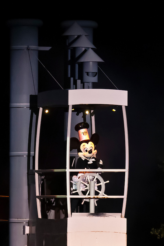 Mickey Mouse as Steamboat Willie, aboard a steamboat with all of the Disney characters, Fantasmic! fireworks and water show, Disney's Hollywood Studios, Walt Disney World, Orlando, Florida USA
