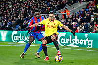Richarlison of Watford holds off Jeffrey Schlupp of Crystal Palace   during the Premier League match between Crystal Palace and Watford at Selhurst Park, London, England on 12 December 2017. Photo by Carlton Myrie / PRiME Media Images.