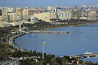 Azerbaijan. Baku Region. Baku. Downtown. Town center. Caspian sea. View on the Boulevard and the National Park. The flag of Azerbaijan is a national symbol and consists of three equal horizontal bands, blue, red, and green; a white crescent and an eight-pointed star (Rub El Hizb) are centered in the red band. The eight points of the star stand for the eight branches of the Turkic people. The blue band is the color of the Turks, the green is for Islam and red is for progress. © 2007 Didier Ruef