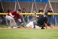 Mahoning Valley Scrappers third baseman Austin Fisher tags out Travis Brewster sliding into third as umpire David Martinez slips during a game against the Batavia Muckdogs on June 22, 2015 at Dwyer Stadium in Batavia, New York.  Mahoning Valley defeated Batavia 15-11.  (Mike Janes/Four Seam Images)
