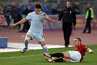 Calcio, Serie A: Roma vs Lazio. Roma, stadio Olimpico, 16 novembre 2008. .Football, Italian serie A: Roma vs Lazio. Rome, Olympic stadium, 16 november 2008..Lazio forward Mauro Zarate, of Argentina, is tackled by AS Roma midfielder Matteo Brighi..UPDATE IMAGES PRESS/Riccardo De Luca