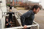 December 22, 2014. Lexington, North Carolina.<br />  Mayor Newell Clark spots Nicole Smith as she does pull-ups as Stan Lanier, back, waits for his turn and Frank Callicutt does dips.<br />   Newell Clark, the 43 year old mayor of Lexington, NC, leads a group of friends and colleagues on a 4 times a week exercise routine around downtown. The group uses existing infrastructure, such as an abandoned furniture factory, loading docks, stairs, and handrails to get fit and increase awareness of healthy lifestyles in a town more known for BBQ.<br /> Jeremy M. Lange for the Wall Street Journal<br /> Workout_Clark