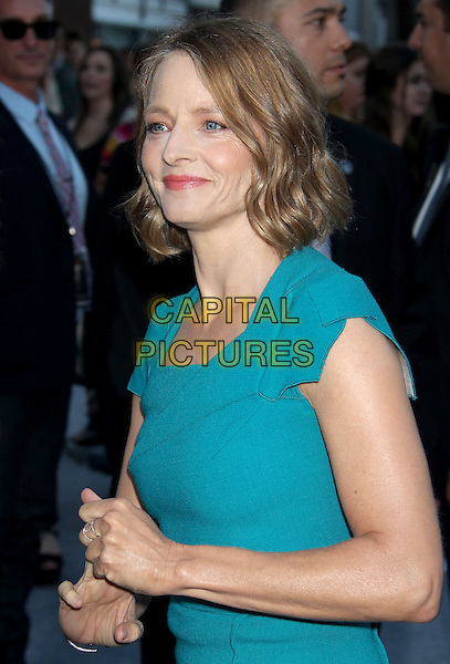 Jodie Foster<br /> &quot;Elysium&quot; Los Angeles Premiere held at the Regency Village Theatre, Westwood, California, UK,<br /> 7th August 2013.<br /> half length blue turquoise dress teal hands <br /> CAP/ADM/RE<br /> &copy;Russ Elliot/AdMedia/Capital Pictures