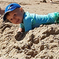 Pictured: Harri Clarkson playing on the beach<br /> Re: A boy-of-two was badly burned after walking onto a discarded beach barbecue buried in the sand.<br /> Harri (CORR) Clarkson screamed in agony when he stepped onto the hot coals.<br /> Mum Laura Ashford, 33, picked him up and saw smoke coming from the soles of his feet.<br /> Little Harri needed hospital treatment for serious burns to his right foot and blistering to his left.<br /> Police and coastguards want information about the careless barbecue revellers at Caswell Bay, near Swansea.