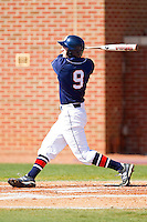 Ian Hundley #9 of the Dayton Flyers follows through on his swing against the High Point Panthers at Willard Stadium on February 26, 2012 in High Point, North Carolina.    (Brian Westerholt / Four Seam Images)