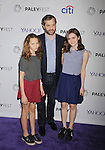 HOLLYWOOD, CA - MARCH 08: (L-R) Actress Iris Apatow, executive producer Judd Apatow and actress Maude Apatow arrive The Paley Center For Media's 32nd Annual PALEYFEST LA - 'Girls' at Dolby Theatre on March 8, 2015 in Hollywood, California.