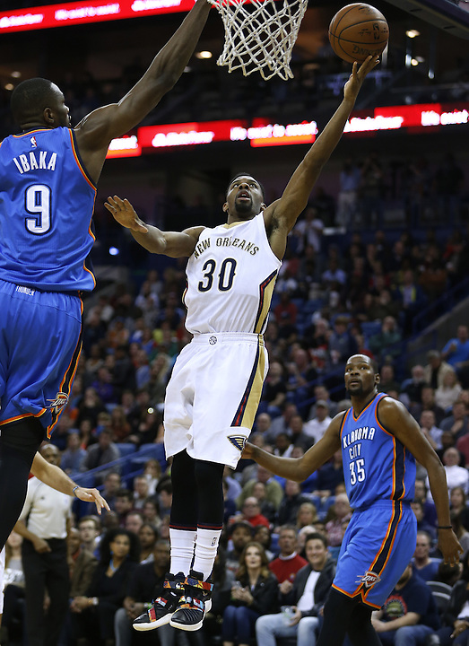 New Orleans Pelicans guard Norris Cole (30) shoots the ball over Oklahoma City Thunder forward Serge Ibaka (9) during the first half of an NBA basketball game Thursday, Feb. 25, 2016, in New Orleans. (AP Photo/Jonathan Bachman)