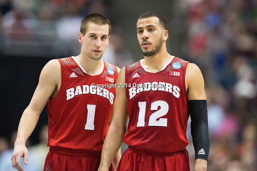 Wisconsin Badgers guards Ben Brust (1) and Traevon Jackson (12) during the Western Regional Final NCAA college basketball tournament game against the Arizona Wildcats Saturday, March 29, 2014 in Anaheim, California. The Badgers won 64-63 (OT). (Photo by David Stluka)
