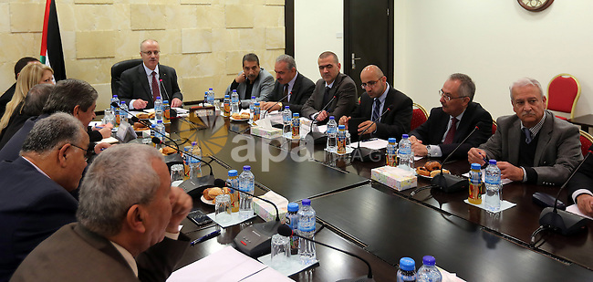 Palestinian Prime Minister Rami Hamdallah meets with Presidents of Palestinian Universities in the West Bank city of Ramallah on Dec. 21, 2015. Photo by Prime Minister Office