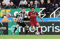Liverpool's Mohamed Salah holds off the challenge from Newcastle United's Javi Manquillo<br /> <br /> Photographer Rich Linley/CameraSport<br /> <br /> The Premier League -  Newcastle United v Liverpool - Sunday 1st October 2017 - St James' Park - Newcastle<br /> <br /> World Copyright &copy; 2017 CameraSport. All rights reserved. 43 Linden Ave. Countesthorpe. Leicester. England. LE8 5PG - Tel: +44 (0) 116 277 4147 - admin@camerasport.com - www.camerasport.com