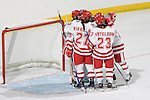 MADISON, WI - SEPTEMBER 29: The Wisconsin Badgers women's hockey team celebrates their opening game victory against the Quinnipiac Bobcats at the Kohl Center on September 29, 2006 in Madison, Wisconsin. The Badgers beat the Bobcats 3-0. (Photo by David Stluka)
