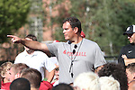 Paul Wulff, Washington State head football coach, talks with his team after the Cougars fall camp workout at Rogers Practice Field on the WSU campus in Pullman, Washington, on August 11, 2010.