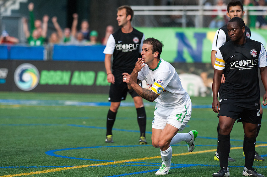 HEMPSTEAD, NY – April 13: Carlos Mendes of the New York Cosmos celebrates a goal against the Atlanta Silverbacks during an NASL match on April 13, 2014 at  Shuart Stadium in Hempstead, New York.