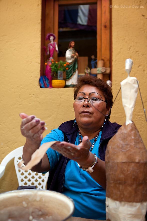 Paola, resident of Casa Xochiquetzal, makes catrinas to sell and make money to support the shelter in Mexico City, Mexico on October 7, 2010. Catrinas are popular figures used during the Day of the Dead celebrations in Mexico. Casa Xochiquetzal is a shelter for elderly sex workers in Mexico City. It gives the women refuge, food, health services, a space to learn about their human rights and courses to help them rediscover their self-confidence and deal with traumatic aspects of their lives. Casa Xochiquetzal provides a space to age with dignity for a group of vulnerable women who are often invisible to society at large. It is the only such shelter existing in Latin America. Photo by Bénédicte Desrus