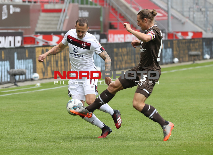 nph00001  17.05.2020 --- Fussball --- Saison 2019 2020 --- 2. Fussball - Bundesliga --- 26. Spieltag: FC Sankt Pauli - 1. FC Nürnberg ---  DFL regulations prohibit any use of photographs as image sequences and/or quasi-video - Only for editorial use ! --- <br /> <br /> Adam Zrelak (11, 1. FC Nürnberg ) Daniel Buballa (15, FC St. Pauli ) <br /> <br /> Foto: Daniel Marr/Zink/Pool//via Kokenge/nordphoto