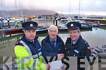 presenting the proceeds of the  Garda Carol singing in Tralee on the 22nd of December in aid of the Fenit lifeboat service were from left Garda Jason Harte, Ger O'Donnell, Fenit Lifeboat and Inspector Martin McCarthy.