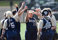 NWA Democrat-Gazette/CHARLIE KAIJO Bentonville West High School players huddle during a softball game, Friday, May 10, 2019 at Tiger Athletic Complex at Bentonville High School in Bentonville. Bentonville West High School defeated Bryant High School 5-3