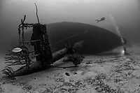 shipwreck, artificial reef, Hilma Hooker on its side with scuba divers, Bonaire, Netherlands Antilles, Caribbean Sea, Atlantic Ocean