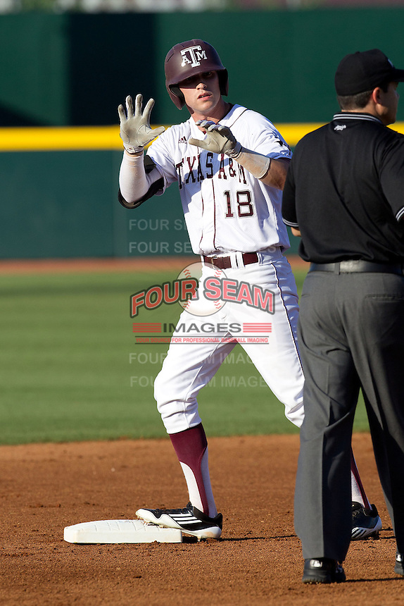 Texas A&M Aggie outfielder Tyler Naquin #18 calls time out at second base after doubling in the first inning during the NCAA Tournament Regional baseball game against the Dayton Flyers on June 1, 2012 at Blue Bell Park in College Station, Texas. The Aggies defeated the Flyers 4-1. (Andrew Woolley/Four Seam Images).