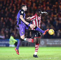 Lincoln City's John Akinde vies for possession with  Port Vale's Antony Kay<br /> <br /> Photographer Andrew Vaughan/CameraSport<br /> <br /> The EFL Sky Bet League Two - Lincoln City v Port Vale - Tuesday 1st January 2019 - Sincil Bank - Lincoln<br /> <br /> World Copyright © 2019 CameraSport. All rights reserved. 43 Linden Ave. Countesthorpe. Leicester. England. LE8 5PG - Tel: +44 (0) 116 277 4147 - admin@camerasport.com - www.camerasport.com