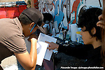 AJ Alexander - Make Up Artist Jessica Fierro working on Jashua Staich (Gregory) and going over lines with Director Erika Liciaga on the set of Mind Over Matter on Friday May 13, 2011..Photo by AJ Alexander