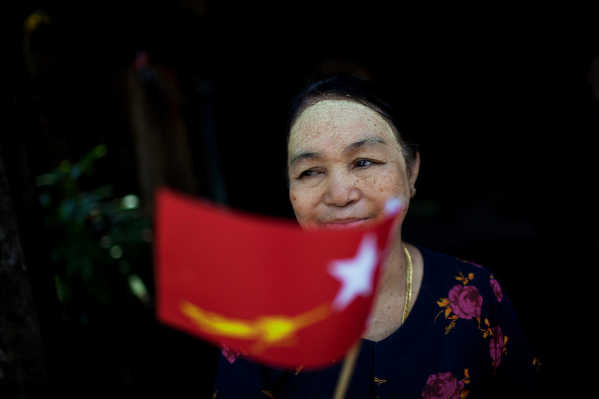 A woman waves a National League for Democracy (NLD) flag during a rally ahead of the country's by elections, in Mingalar Taung Nyunt township, in Yangon, Myanmar, March 25, 2012. NLD candidate Phyu Phyu Thin is running for election in the Mingalar Taung Nyunt township. Hundreds of supporters turned out for the rally.