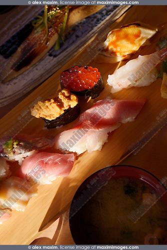 Closeup of nigiri sushi and smoked eel at a Japanese sushi restaurant. Tokyo, Japan.