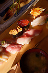 Closeup of nigiri sushi and smoked eel at a Japanese sushi restaurant. Tokyo, Japan.