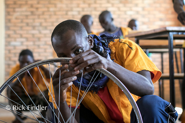 BURUNDI, Ruyigi: 10 June 2015 Ruyigi Re-education Centre Feature.<br /> See accompanying article for general information. <br /> Pictured: An inmate learns how to fix a bicycle during a skills lesson. <br /> Rick Findler / Story Picture Agency