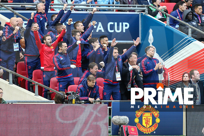Louis van Gaal (Manager) of Manchester United (front row, 2nd from right) and the rest of the Manchester United bench celebrate the opening goal from Marouane Fellaini of Manchester United (not pictured) during the FA Cup Semi-Final match between Everton and Manchester United at Wembley Stadium, London, England on 23 April 2016. Photo by David Horn / PRiME Media Images.