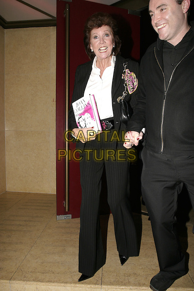 "CILLA BLACK.Launch party for Joan Collins' new book, ""Misfortune's Daughters"", Frankies, Yeoman's Row, London, .October 19th 2004..full length funny face.Ref: AH.www.capitalpictures.com.sales@capitalpictures.com.©Capital Pictures."