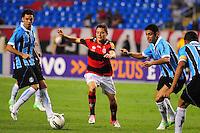 ATENCAO EDITOR: FOTO EMBARGADA PARA VEÍCULOS INTERNACIONAIS. - RIO DE JANEIRO, RJ, 16 DE SETEMBRO DE 2012 - CAMPEONATO BRASILEIRO - FLAMENGO X GREMIO - Adryan, jogador do Flamengo, cercado por 3 marcadores durante partida contra o Gremio, pela 25a rodada do Campeonato Brasileiro, no Stadium Rio (Engenhao), na cidade do Rio de Janeiro, neste domingo, 16. FOTO BRUNO TURANO BRAZIL PHOTO PRESS